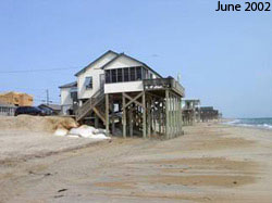 Figure  12.6  Retreat.  (a)  June  2002. Houses along the shore in Kitty Hawk,  North  Carolina.  Geotextile  sand  bags  protect the septic tank buried  in  the  dunes. (b) October 2002. (c) June 2003 [Photo source: © James G. Titus, used with permission].